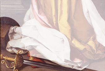 作中、下部に描かれた車輪と剣